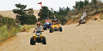 Kids and Families ATVing on the Untamed Dunes near North Bend, Oregon